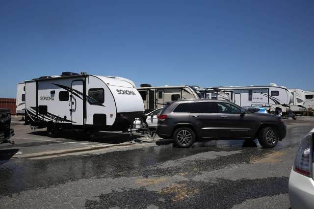 Alaina and Cal Williams leave the San Francisco RV Resort in Pacifica in June. The Williamses recently purchased the RV and are traveling across the country after moving from Oakland.